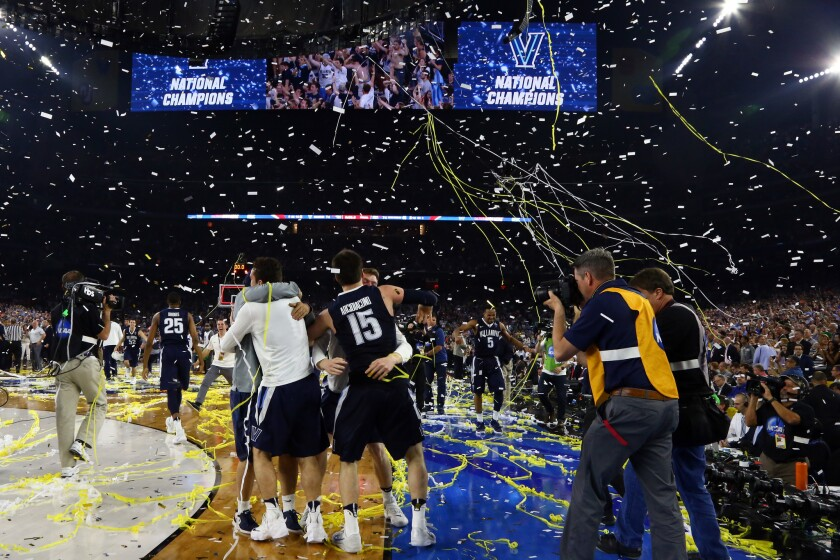 Villanova players celebrate after defeating North Carolina to win the NCAA championship game at NRG Stadium in Houston on April 4.