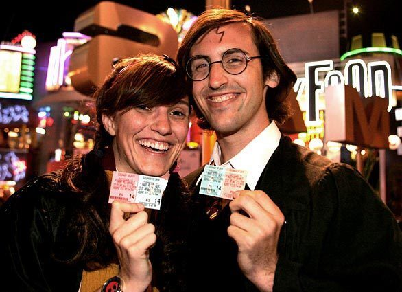 """Jullian Lawson, 21, dressed as Lavender Brown, and Daniel Hurst, 22, as Harry Potter, were on hand for the midnight showing of """" Harry Potter and the Half-Blood Prince"""" at Universal CityWalk."""