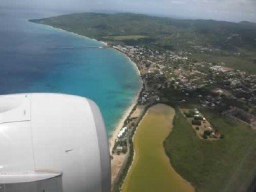 Flying in over the west end of St. Croix. The salt pond (a natural color), just inland of the beach is used by many waterbirds as a foraging area.