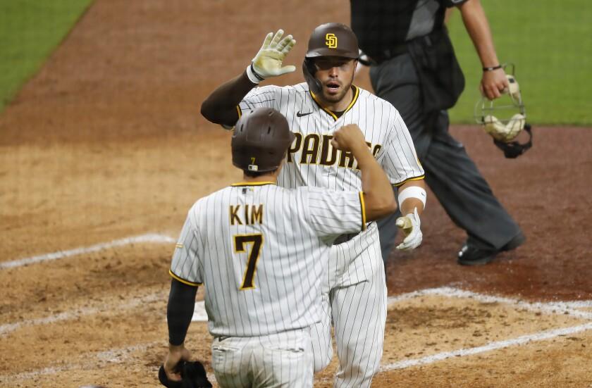 The Padres' Victor Caratini, Ha-seong Kim
