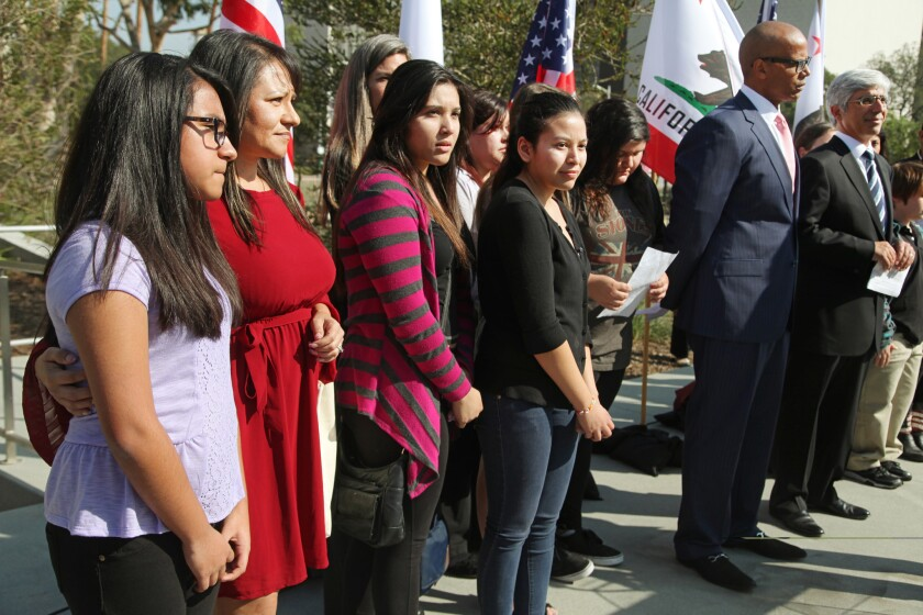 Nine California public school students sued the state to abolish its laws on teacher tenure, seniority and other protections. Above, the students with their lawyers in downtown L.A. on Jan. 27, 2014.