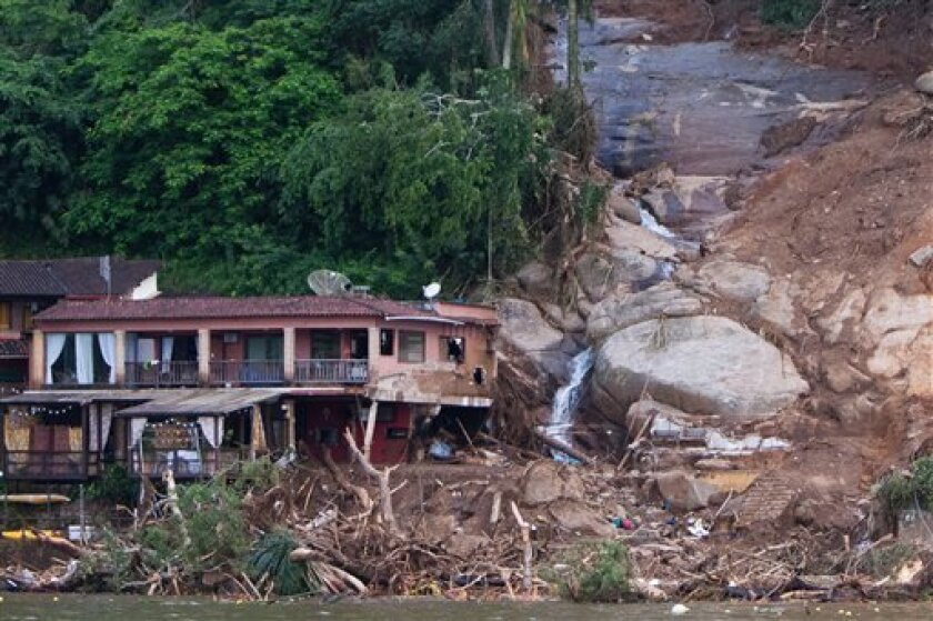 A damaged inn is seen after a mudslide in Ilha Grande, an island off the city of Angra dos Reis near Rio de Janeiro, Brazil, Friday, Jan. 1, 2010. A rain-soaked hillside collapsed on three houses and an upscale lodge after New Year celebrations, killing at least 15 people, according to Brazilian authorities. (AP Photo/Felipe Dana)
