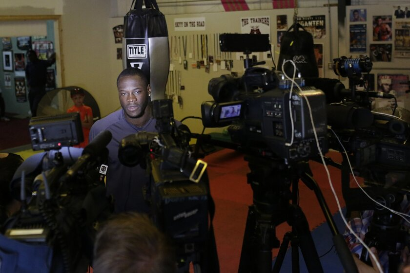 WBC heavyweight boxing champion Deontay Wilder speaks to the media at Skyy Boxing Gym, Thursday, May 28, 2015, in Northport, Ala. Wilder is preparing for his first title defense, when he takes on Eric Molina on Saturday, June 13 in Birmingham. (AP Photo/Brynn Anderson)