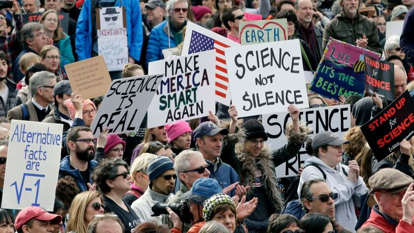 Members of the scientific community, environmental advocates and supporters demonstrate Sunday, Feb. 19, 2017, in Boston to call attention to what they say are the increasing threats to science and scientific research.