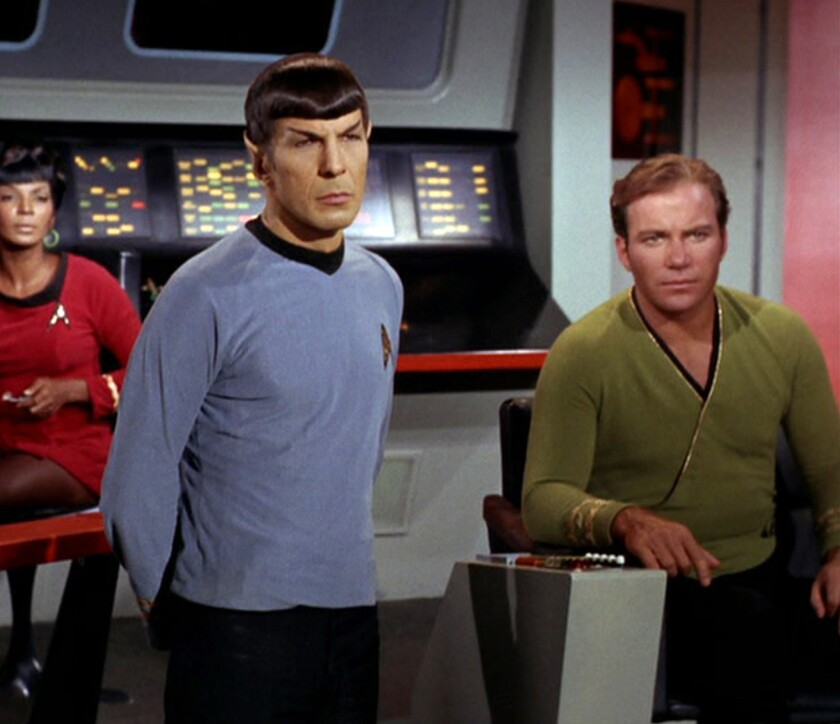 """A scene from """"Star Trek's"""" """"The Trouble With Tribbles"""" episode first aired in 1967, featuring, from left, Nichelle Nichols as Uhura, Leonard Nimoy as Mr. Spock and William Shatner as Captain James T. Kirk."""