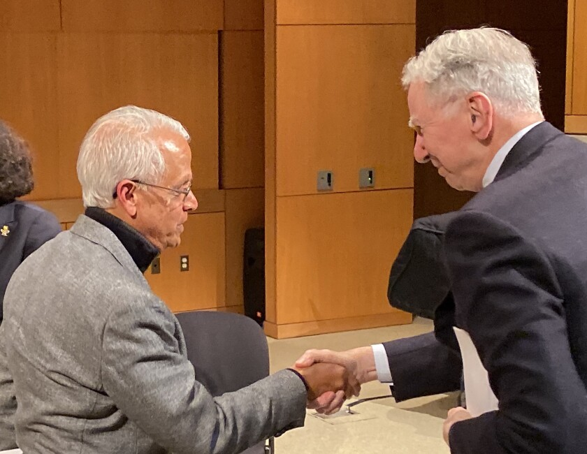 Scripps Institution of Oceanography Center for Atmospheric Sciences director V. Ramanathan and Qualcomm founder Irwin Jacobs greet each other following Gore's talk.