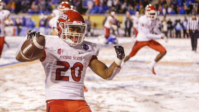 Fresno State running back Ronnie Rivers celebrates the game-winning touchdown against Boise State in overtime in a game for the Mountain West championship.