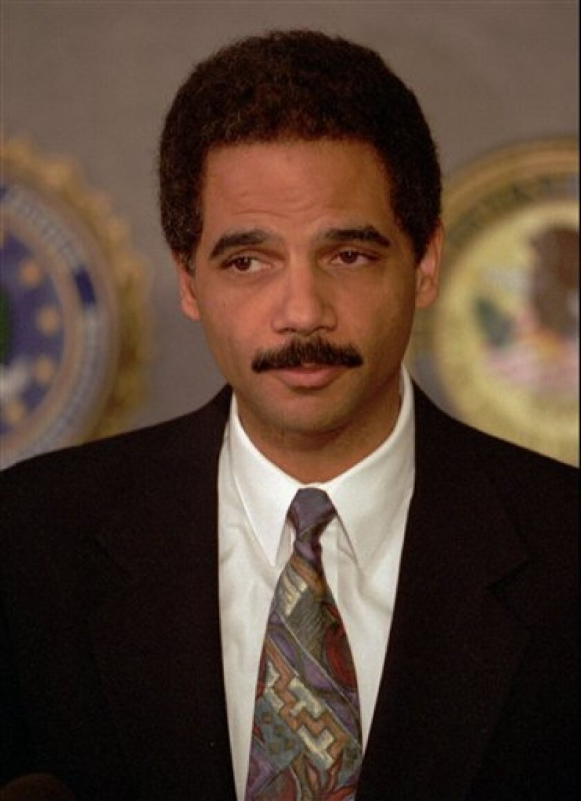 This Nov. 4, 1993 file photo  U.S. Attorney Eric Holder Jr. is shown during a news conference in Washington. Attorney General-designate Holder could set the tone for a more open White House by speaking out this week on Capitol Hill against Bush administration policies promoting government secrecy