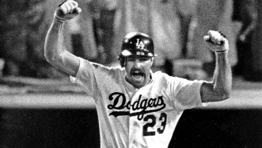 Kirk Gibson raises his arms in celebration as he rounds the bases after hitting a game–winning two r
