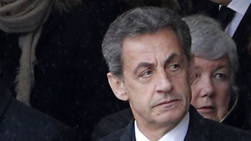 Former French President Nicolas Sarkozy attending the funeral police officer in Paris on Wednesday.