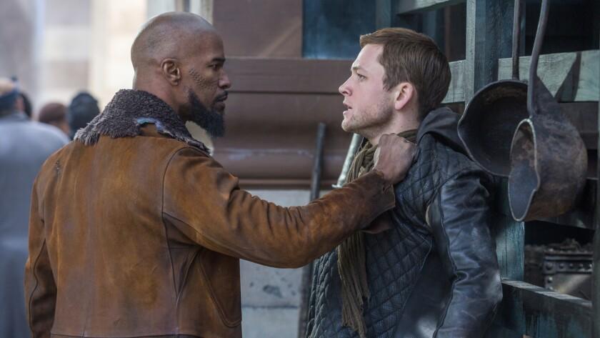 "Jamie Foxx, left, and Taron Egerton in the movie ""Robin Hood."""