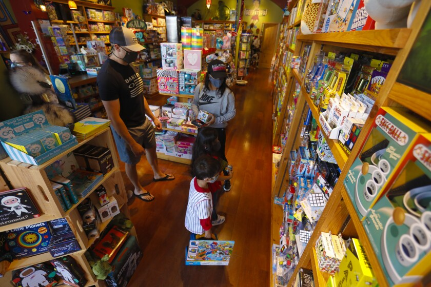 Renee and Paul Bre shopped with their children Phillip and Bell at Geppetto's Toys in UTC (University Town Center) Mall in La Jolla. On Friday, the mall officially reopened with modified business hours.