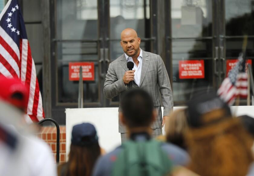 Mixed martial arts fighter Tito Ortiz speaks at a Recall Gavin Newsom rally