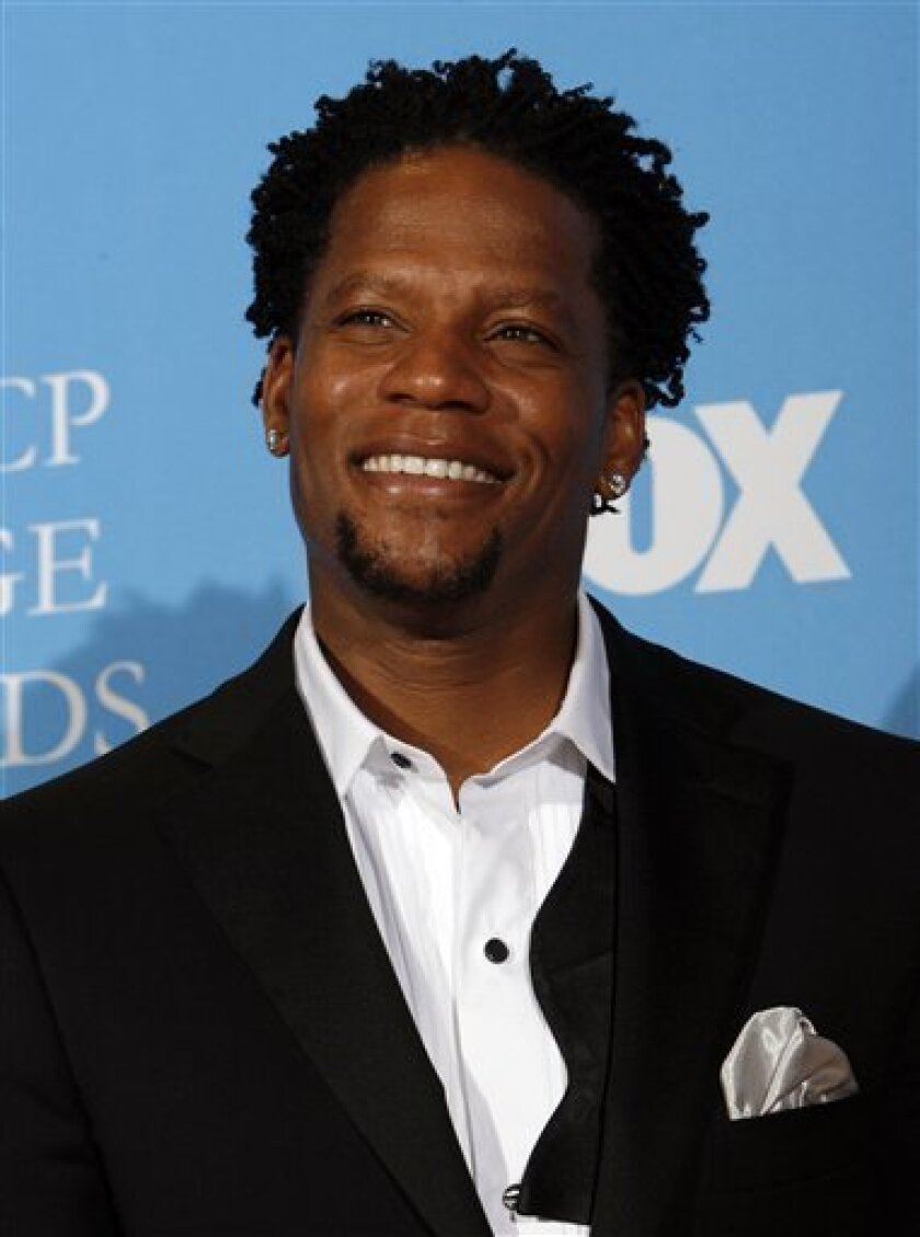 In this Feb. 14, 2008 file photo, D.L. Hughley poses in the press room  at the 39th NAACP Image Awards in Los Angeles.  (AP Photo/Gus Ruelas, file)