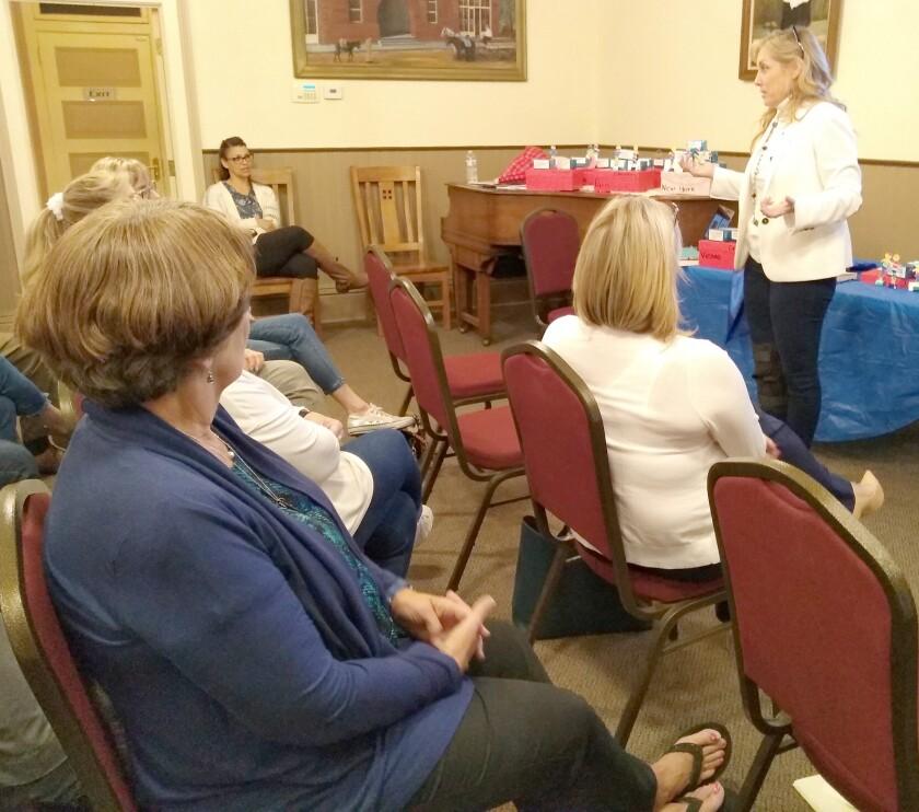Soroptimist International member Michelle Vanderlinden-Enfield, right, speaks at a Soroptimist International of Ramona event.