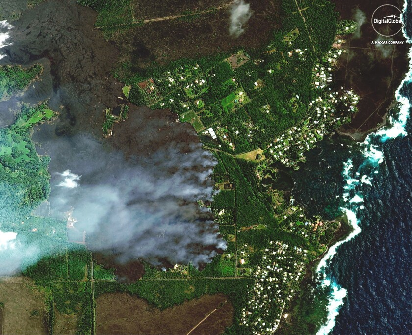 This satellite image provided by Digital Globe captured June 3, 2018, shows advancing lava flows on
