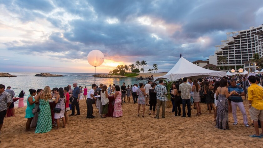 Diners gather on the beach at Ko Olina for one of the many Oahu dining experiences at the festival.