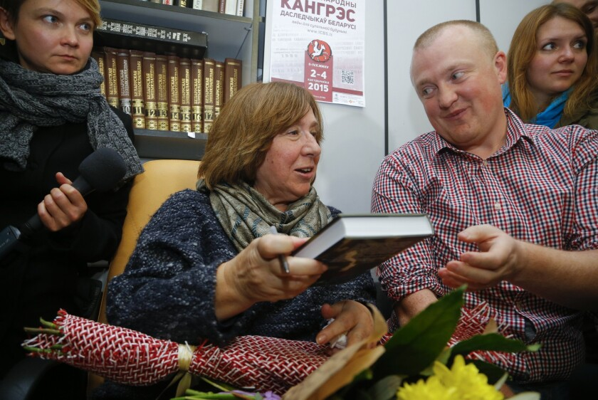 Svetlana Alexievich signs autographs after her news conference in Minsk.