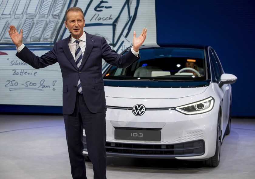 FILE - In this Monday, Sept. 9, 2019, file photo, CEO of Volkswagen Herbert Diess introduces the new VW ID.3 at the IAA Auto Show in Frankfurt, Germany.(AP Photo/Michael Probst, file)
