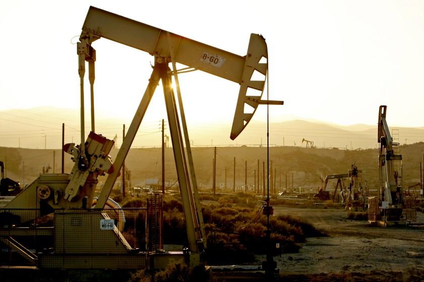 An oil rig pumps crude oil near the town of Maricopa