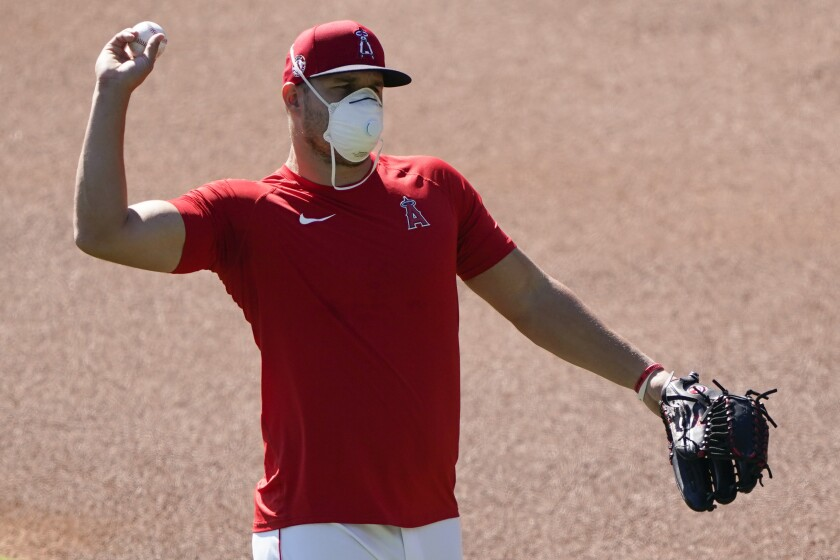 Angels center fielder Mike Trout throws during practice at Angel Stadium on July 4.