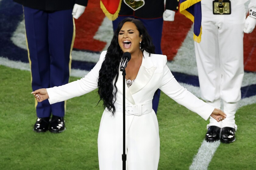 Singer Demi Lovato performs the national anthem prior to Super Bowl LIV between the San Francisco 49ers and the Kansas City Chiefs at Hard Rock Stadium on February 2, 2020, in Miami, Florida