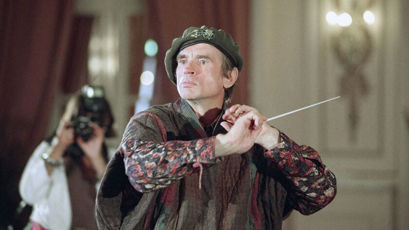 FILE - In this Sept. 6, 1991 file photo, dancer Rudolf Nureyev concentrates as he conducts for the v