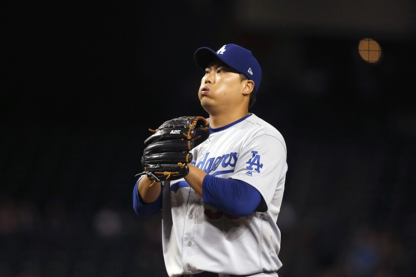 Dodgers starting pitcher Hyun-Jin Ryu pauses on the mound during the first inning of a loss to the Arizona Diamondbacks on Thursday.