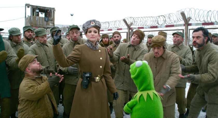"""Tina Fey and Kermit the Frog in """"Muppets Most Wanted."""""""