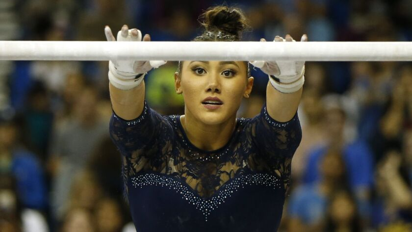 UCLA's Kyla Ross competes on uneven bars during a Pac-12 meet against Arizona State at Pauley Pavilion on January 21, 2019.