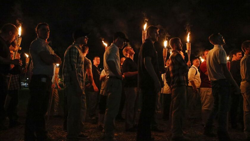 White nationalist groups march with torches through the University of Virginia campus in Charlottesville in 2017.