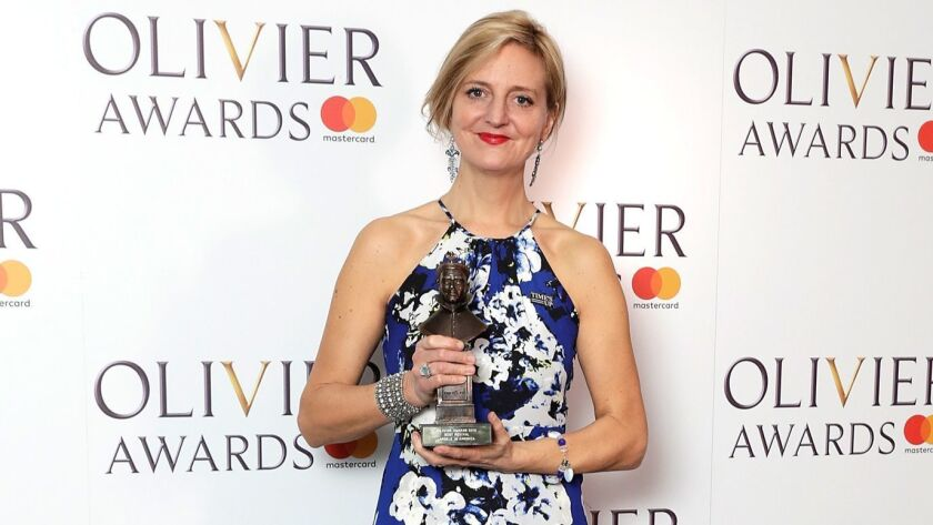 """Marianne Elliott, accepting the Olivier Award in April in London for the National Theatre revival of """"Angels in America,"""" now on Broadway and up for 11 Tony Awards."""