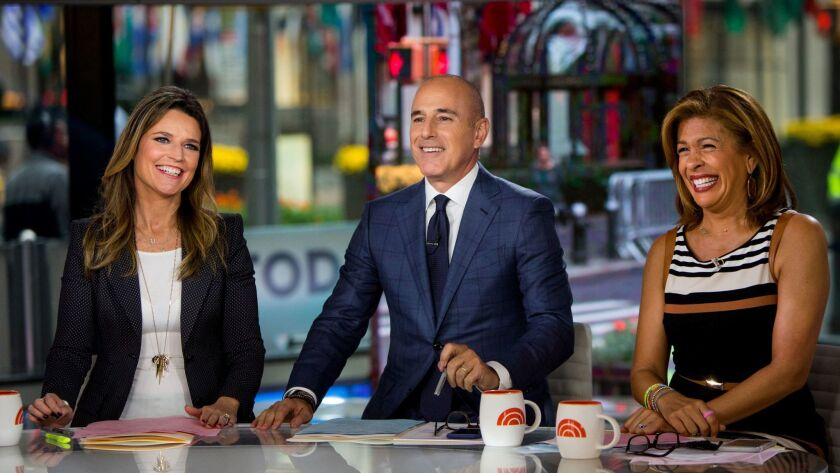 "Savannah Guthrie, left, Matt Lauer and Hoda Kotb on the set of NBC's ""Today"" in October."