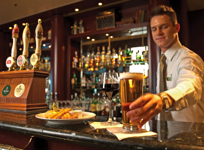 Pub grub like fish and chips are on offer, and meals can come with room-temperature beer, aboard Cunard's 2,620-passenger Queen Mary 2.