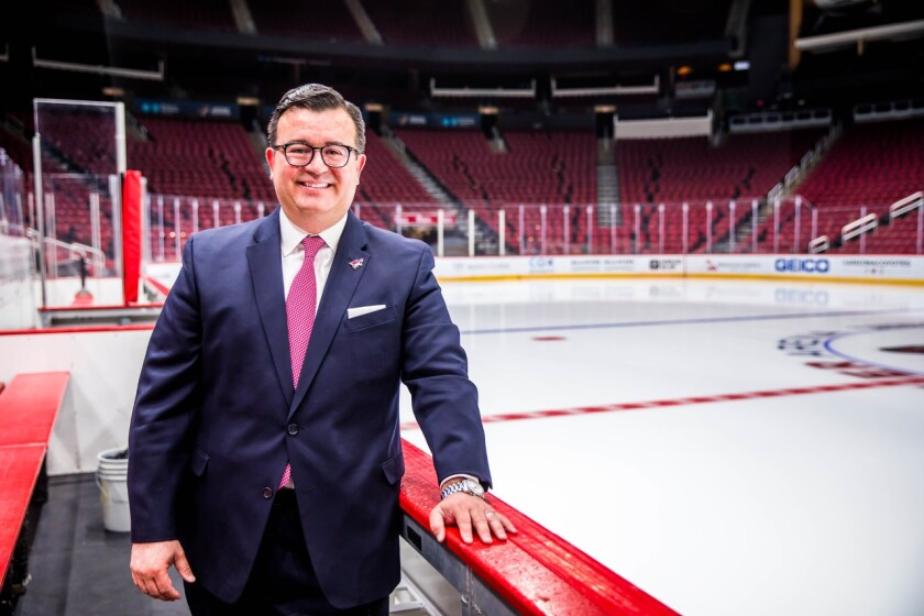 Xavier A. Gutierrez of the Arizona Coyotes stands next to the ice.