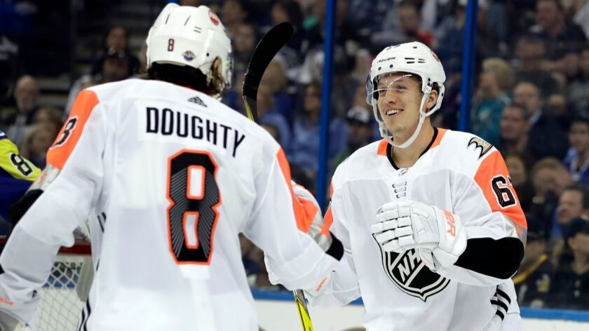 Pacific Division's Rickard Rakell, right, of the Anaheim Ducks, is congratulated by Drew Doughty, of