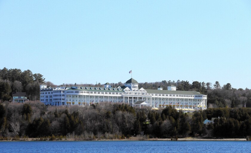 The Grand Hotel on Mackinac Island, Mich., is among those listed as great hotels on the water for summer travel.
