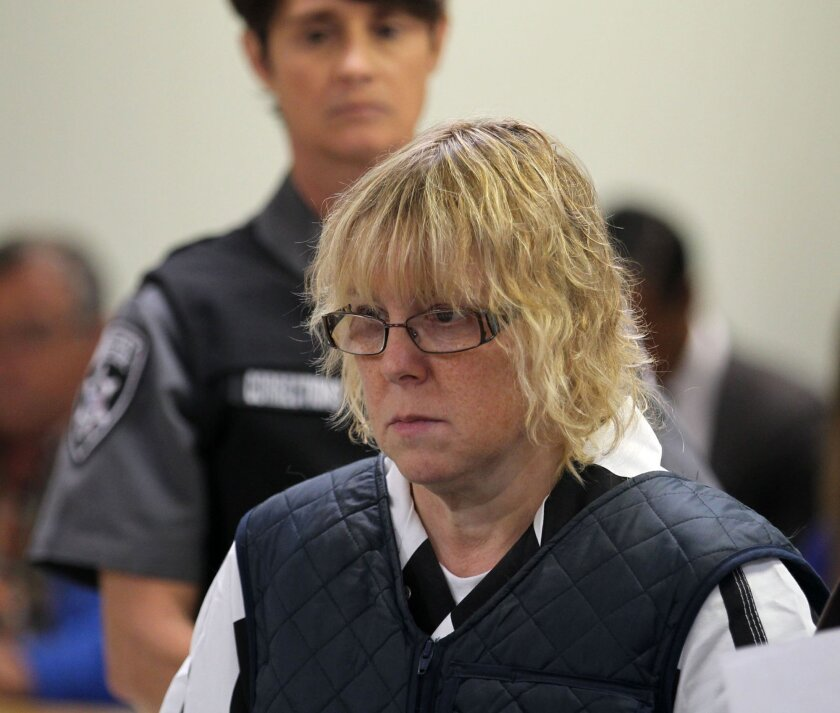 FILE - In this June 15, 2015, file photo, Joyce Mitchell appears before Judge Mark Rogers in Plattsburgh, N.Y., City Court for a hearing. The New York prison worker accused of smuggling hacksaw blades in frozen hamburger meat to two killers who later broke out and spent more than two weeks on the run will face charges in court and will be arraigned on Tuesday, July 28, 2015. (G.N. Miller/New York Post via AP, Pool, File)