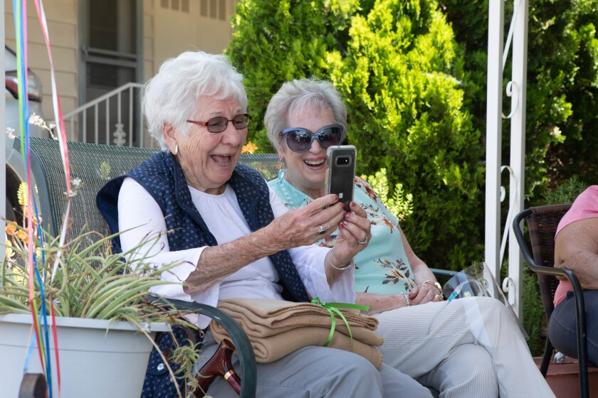 """Jo Hamann sees """"Happy 100th"""" birthday wishes via Facetime."""