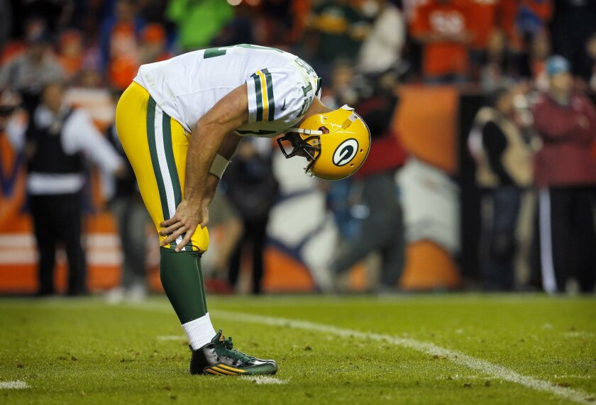 Green Bay Packers quarterback Aaron Rodgers (12) reacts to an incomplete pass during the second half of an NFL football game against the Denver Broncos, Sunday, Nov. 1, 2015, in Denver. (AP Photo/Joe Mahoney)
