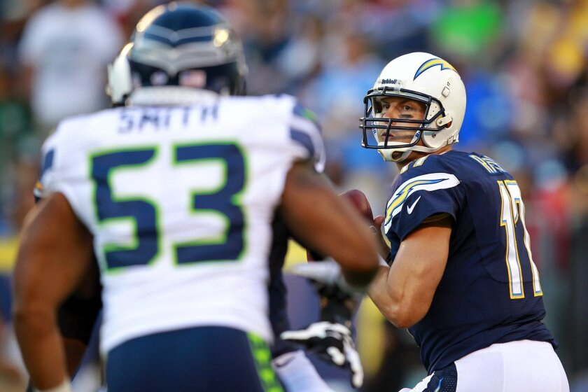 Chargers Philip Rivers throws on the first drive against the Seahawks.