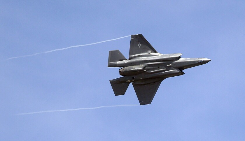FILE - In this Wednesday, Sept. 2, 2015, file photo, an F-35 jet arrives at its new operational base