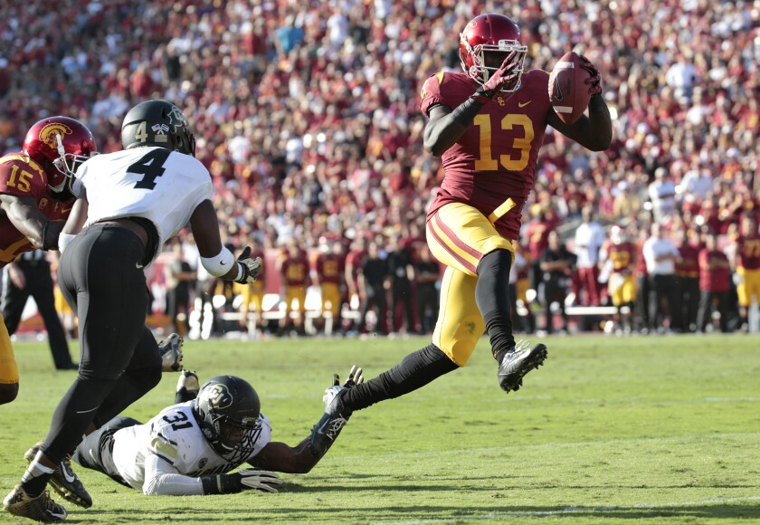 USC tight end Bryce Dixon high steps into the end zone against Colorado on Oct. 18, 2014.