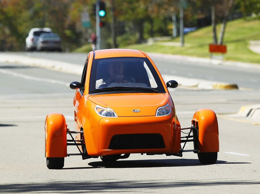 The three-wheeled Elio gets a test drive on the streets of La Jolla on Wednesday. The American made two seat car gets up to 84 MPG and sells for under $7,000. The car will be on display at the Miramar Air Show this weekend.