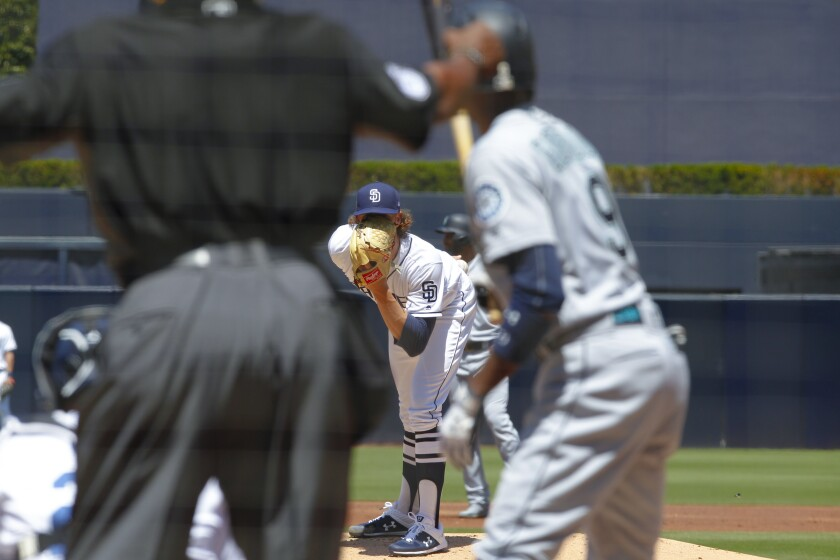 Padres' Chris Paddack pitches last season against Seattle.