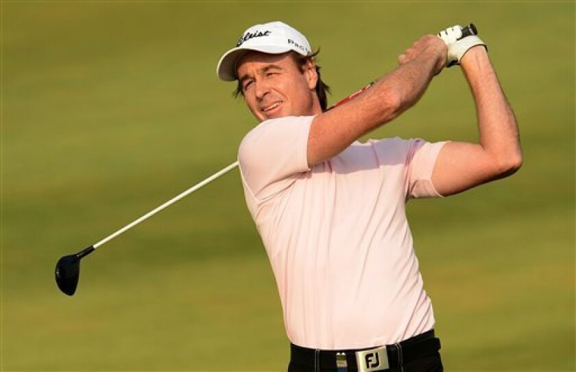 In this photo released by OneAsia, Brett Rumford of Austrlaia watches his tee shot during the third round of China Open golf tournament at Tianjin Binhai Lake Golf Club in Tianjin, China on Saturday, May 4, 2013. (AP Photo/OneAsia, Paul Lakatos) NO LICENSING