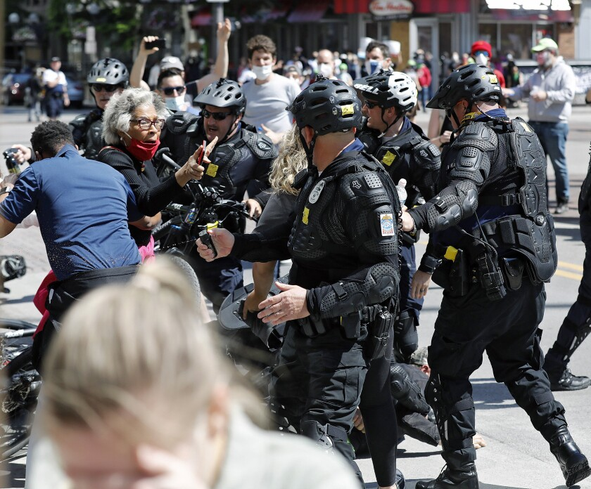 Congresswomen Joyce Beatty interacts with police during a protest on the death of George Floyd on South High Street near the Ohio Statehouse in Columbus, Ohio on Saturday May 30, 2020. Floyd died after being restrained by Minneapolis police officers on Memorial Day. [Kyle Robertson/The Columbus Dispatch via AP)