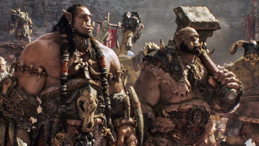 "Orc chieftain Durotan, voiced by Toby Kebbell, left, and Orgrim, voiced by Rob Kazinsky, in ""Warcraft."""