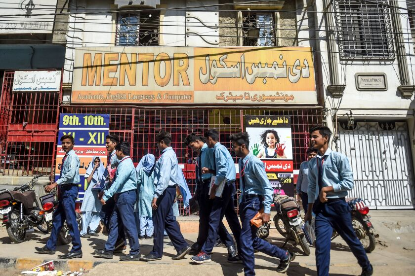 Students leave a school in Karachi, Pakistan, that was closed by the provincial government in late February.