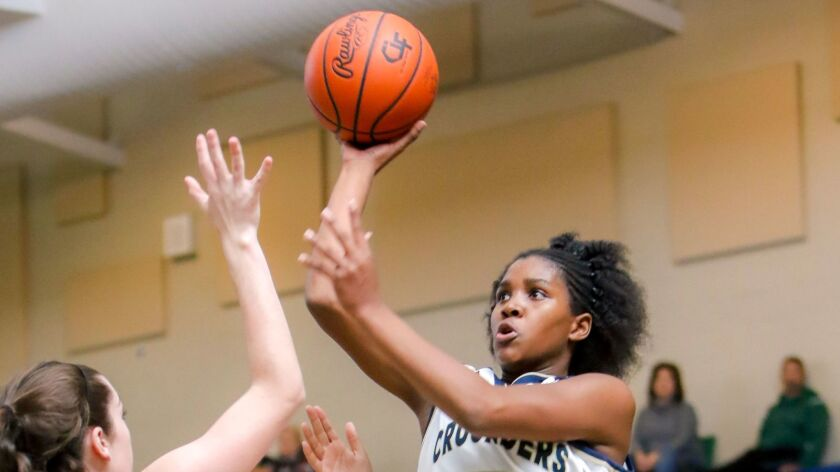 Mater Dei Catholic's Chloe Webb takes a shot over the defense of Poway's Ashlyn Snead during the fir